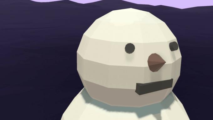 雪だるまの頭に顔のパーツを取り付ける